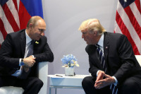 Меркель приветствовала личную встречу Путина и Трампа
