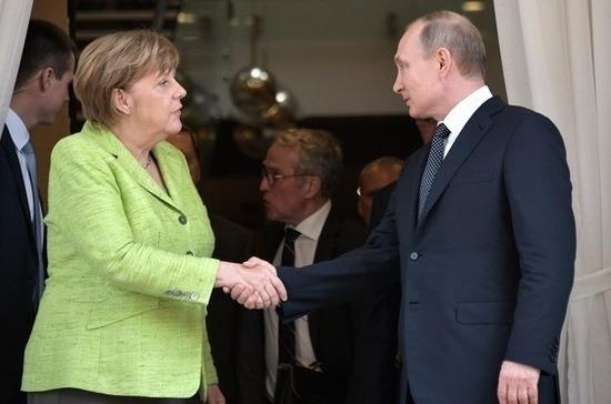 Путин и Меркель договорились продолжить работу в «нормандском формате»