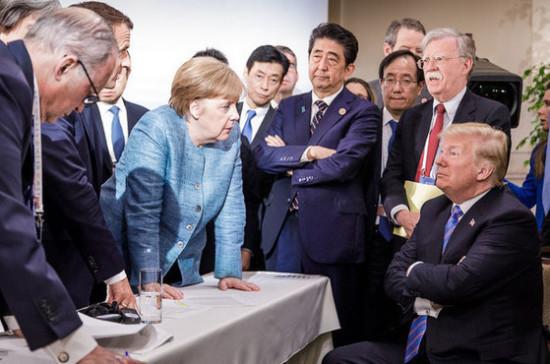Захарова прокомментировала фотографию Трампа и Меркель на саммите G7