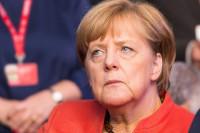 Меркель и Макрон приветствовали договорённости о новогоднем перемирии в Донбассе