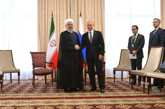 Роухани призвал Путина к тесному сотрудничеству с учётом ситуации в регионе и санкций