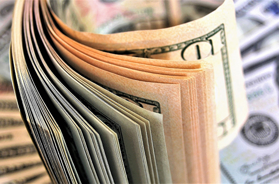 Центробанк повысил курс доллара на 11 марта до 72,02 рубля