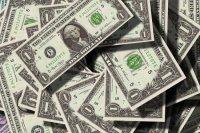 Курс доллара упал ниже 77 рублей