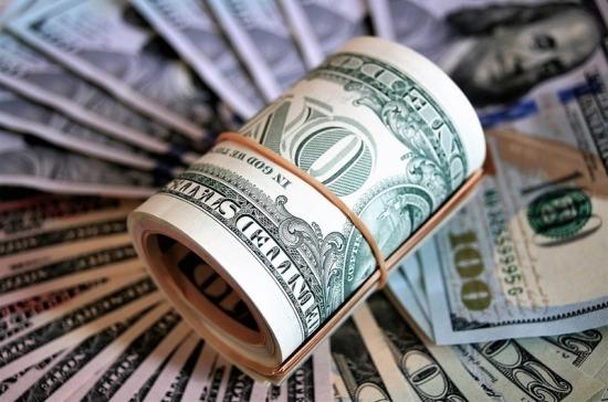 Рубль укрепился к доллару
